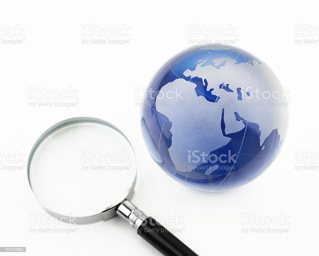 Magnifier and Globe royalty-free stock photo