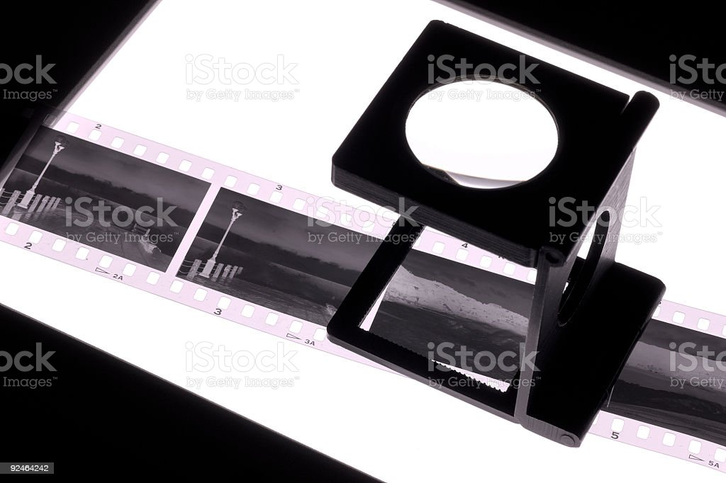 Magnifier and negative film royalty-free stock photo