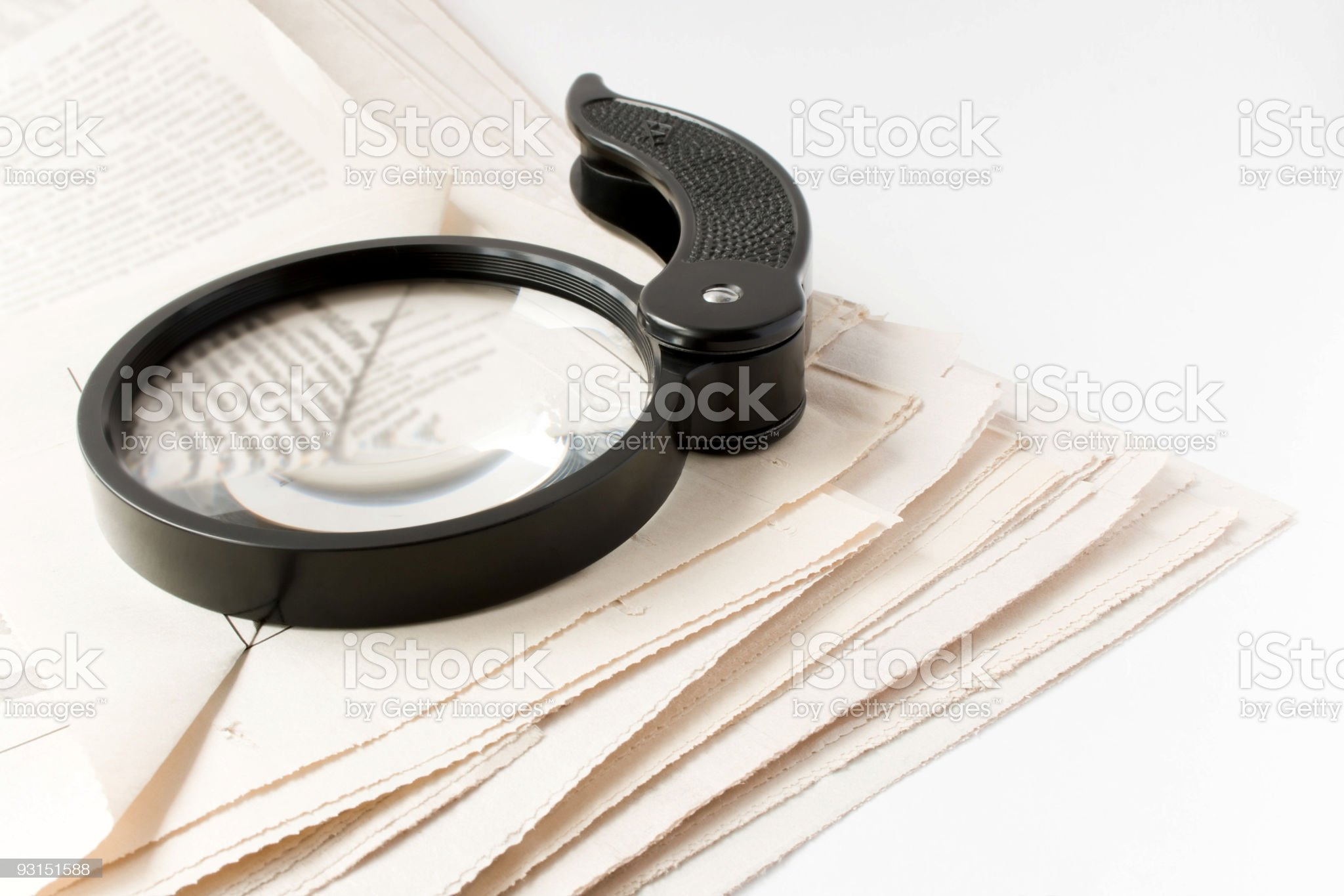 Magnifier and newspaper royalty-free stock photo