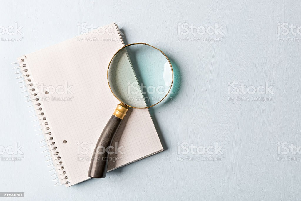 magnifier and notebook stock photo