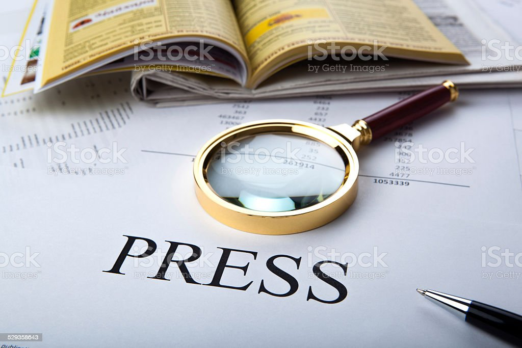 Magnifier and sign the press stock photo