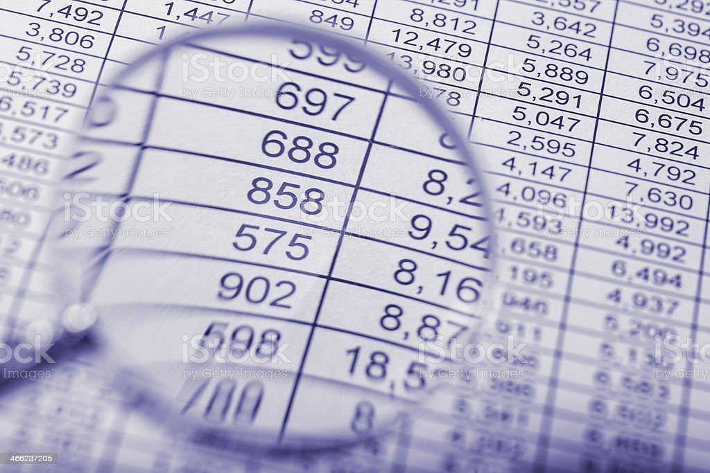 Magnifier view financial data stock photo