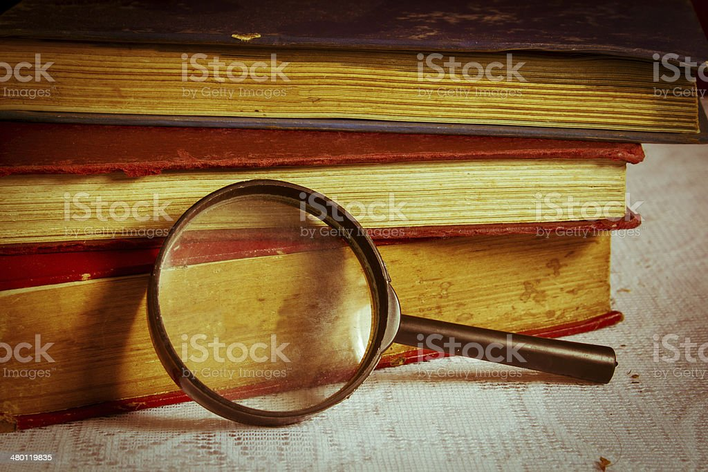 Magnifier with books. royalty-free stock photo