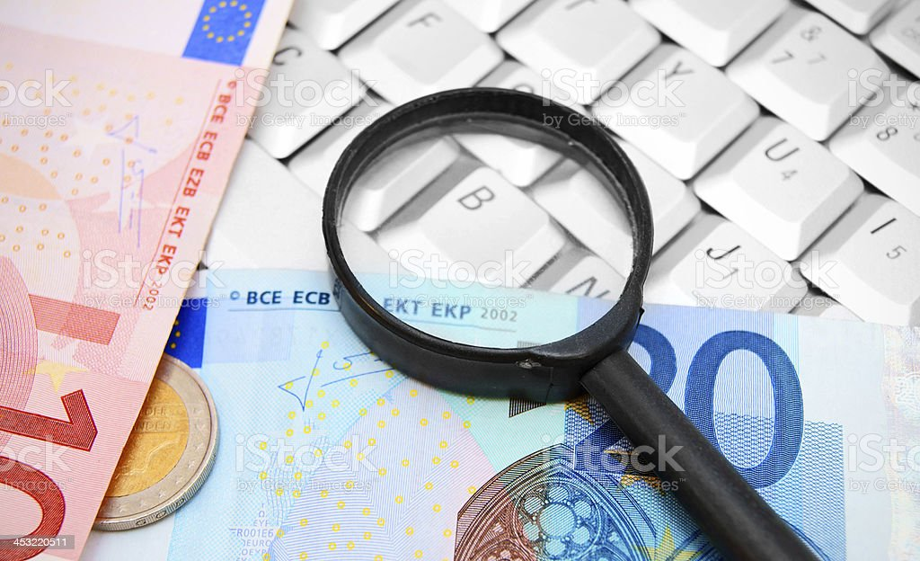 Magnifiers and euro on the keyboard. royalty-free stock photo