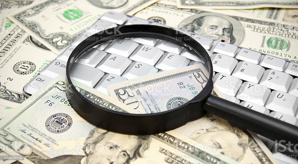 Magnifiers, money and the keyboard. royalty-free stock photo