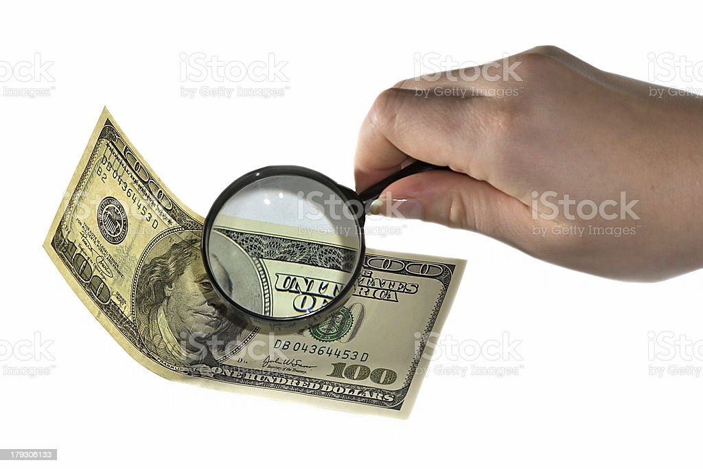magnifying and dollar royalty-free stock photo