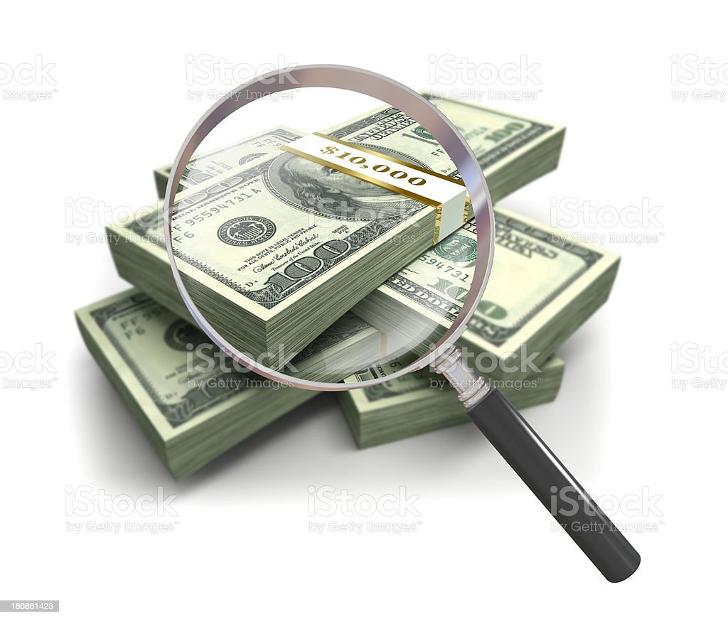 Magnifying glass and $100 Dollar bills, isolated royalty-free stock photo