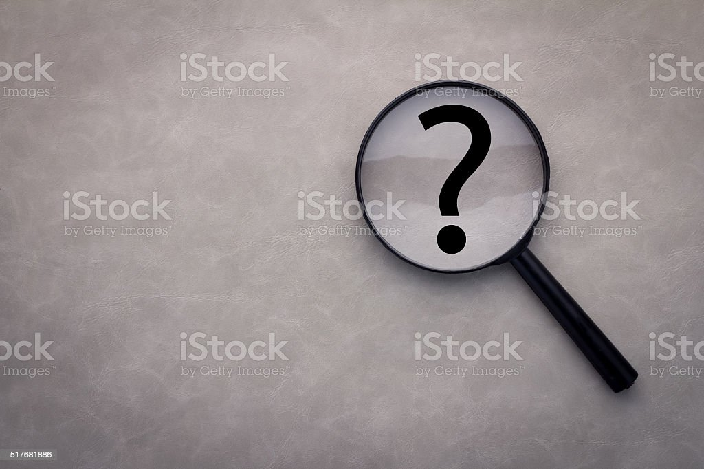 magnifying glass and a question mark on the leather stock photo
