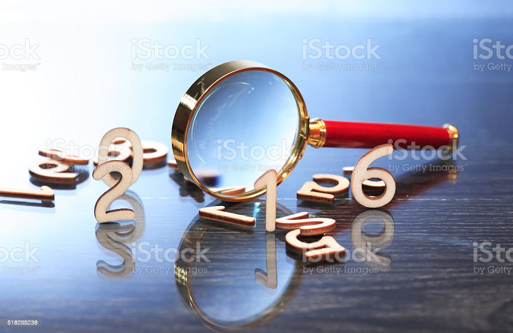 Magnifying Glass And Digits stock photo