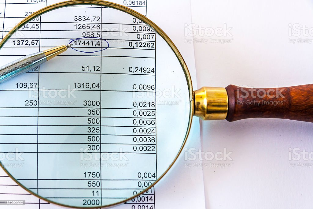 Magnifying Glass And Financial Document stock photo