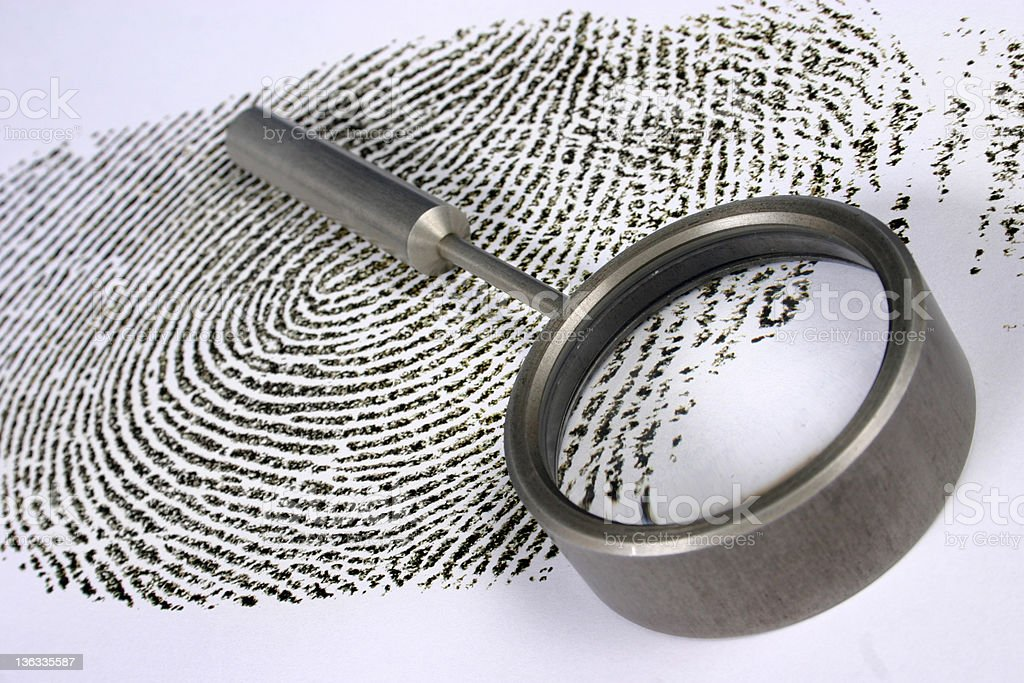 Magnifying glass and fingerprint royalty-free stock photo
