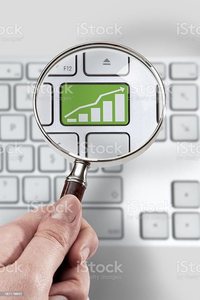 Magnifying glass and investment Concept stock photo