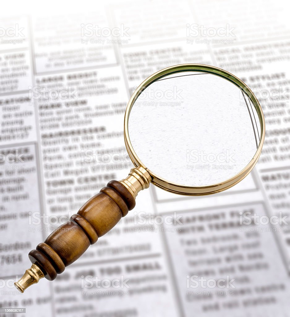 Magnifying Glass and newspaper royalty-free stock photo