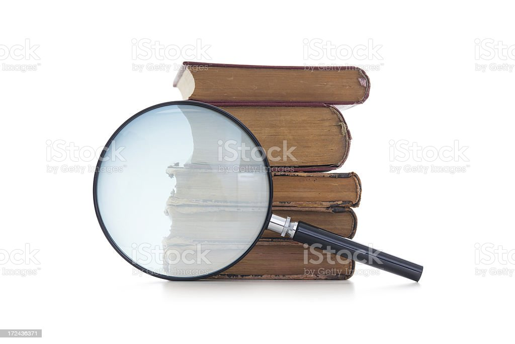 Magnifying glass and old books royalty-free stock photo