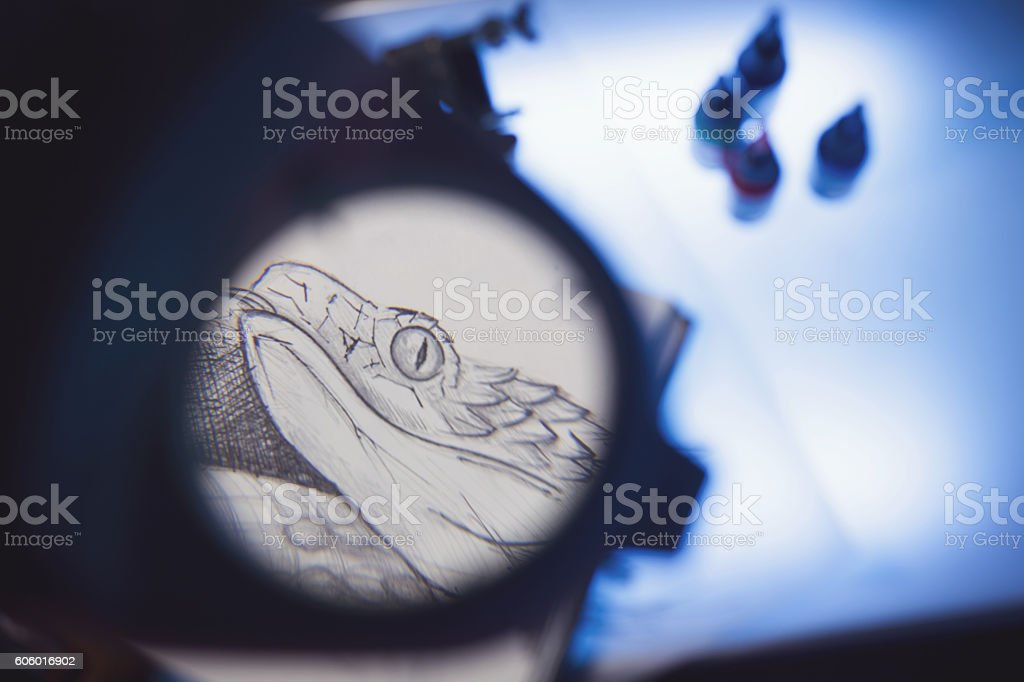 Magnifying glass and scetch stock photo