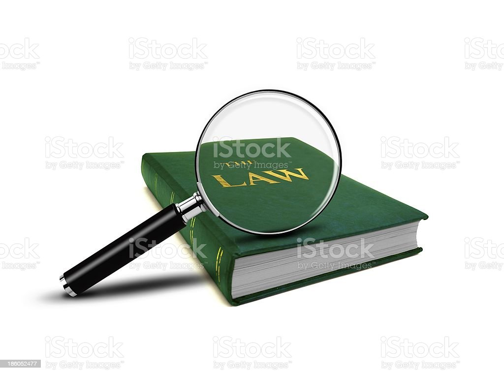 Magnifying Glass and the Book of Law royalty-free stock photo