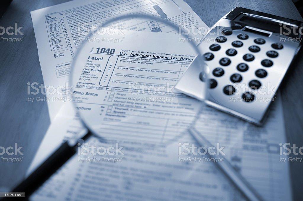 Magnifying Glass Examining 1040 Tax Form royalty-free stock photo