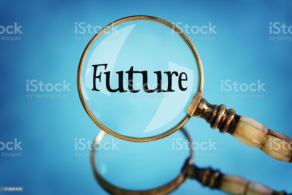 Magnifying glass focus on the word future stock photo