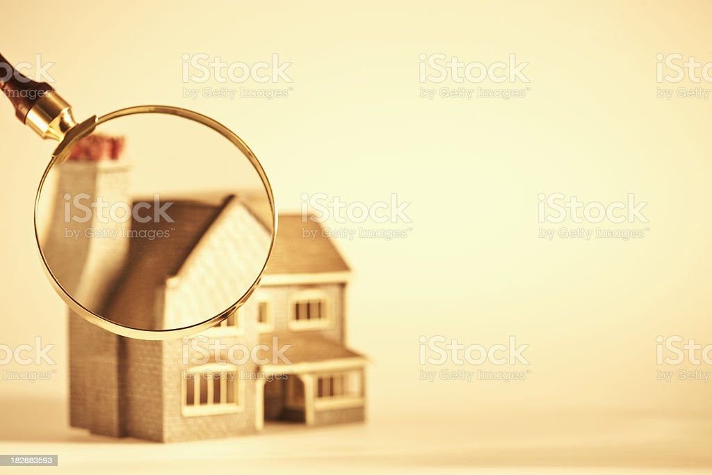 Magnifying Glass Focused on a Toy House royalty-free stock photo