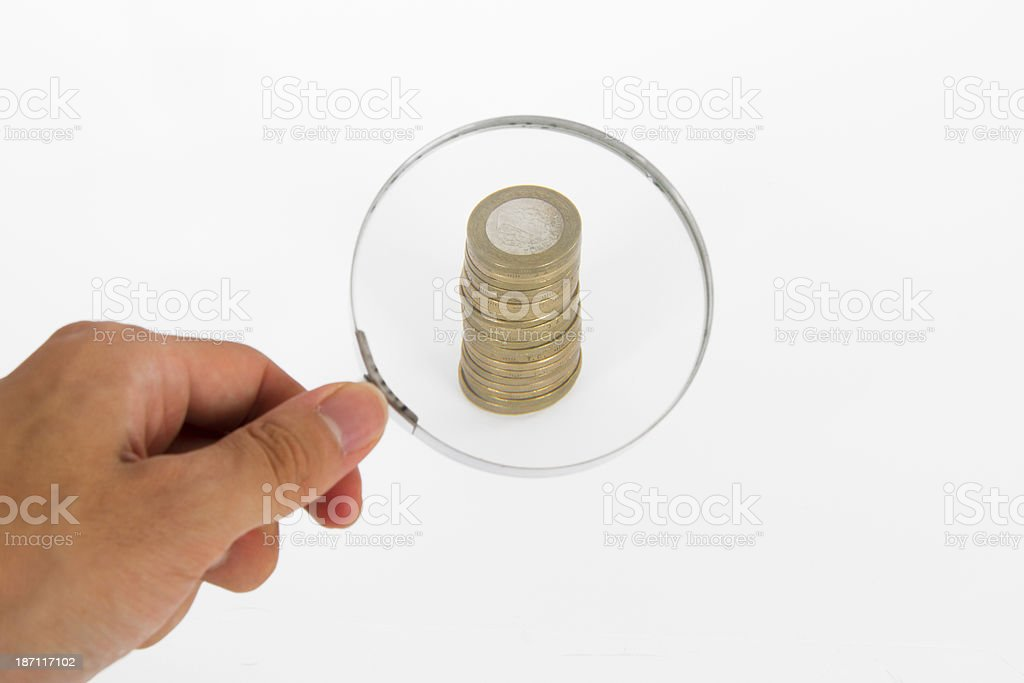 Magnifying Glass Focused on Coins royalty-free stock photo