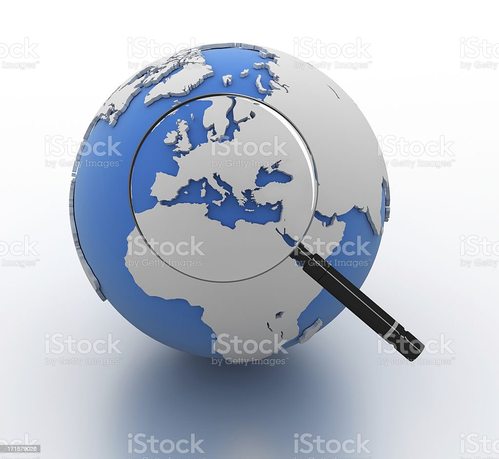 Magnifying glass focusing on Europe on a globe royalty-free stock photo