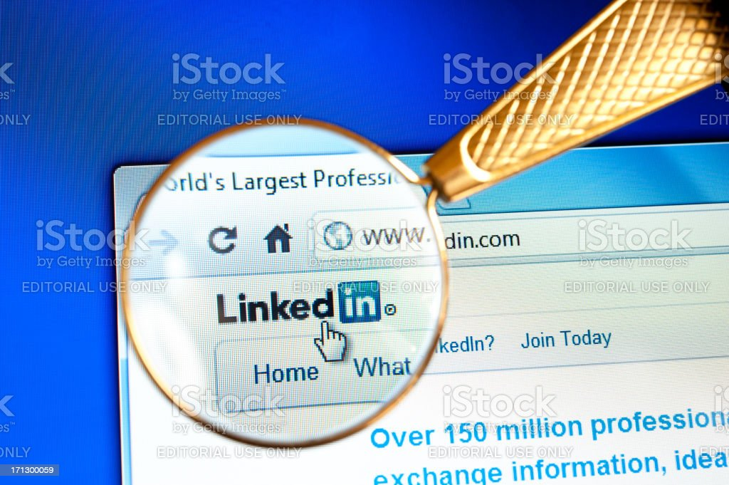 Magnifying glass held over Linkedin website stock photo