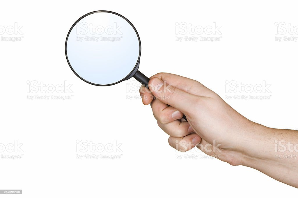 Magnifying glass in hand royalty-free stock photo