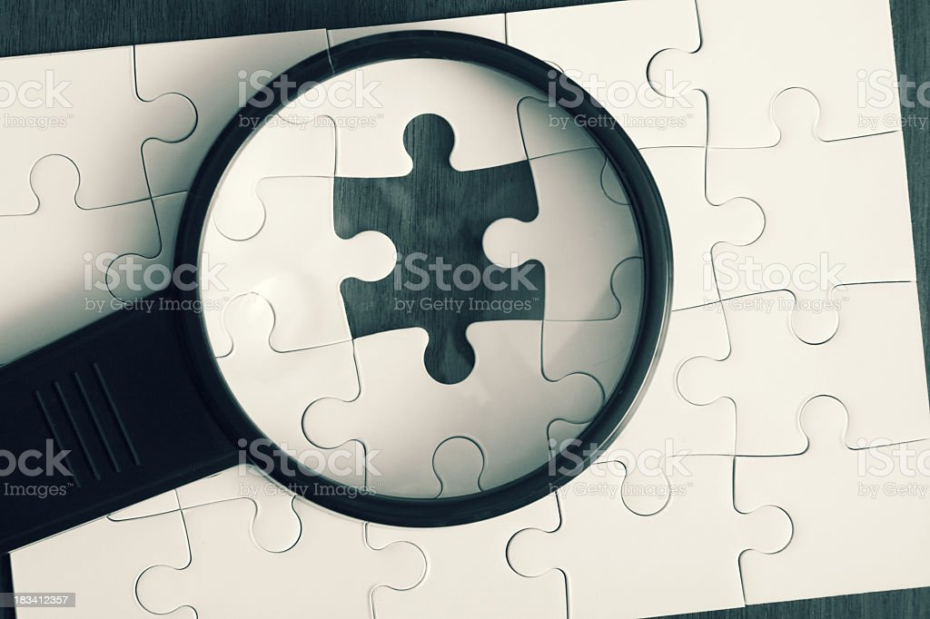 Magnifying Glass Jigsaw Puzzle royalty-free stock photo