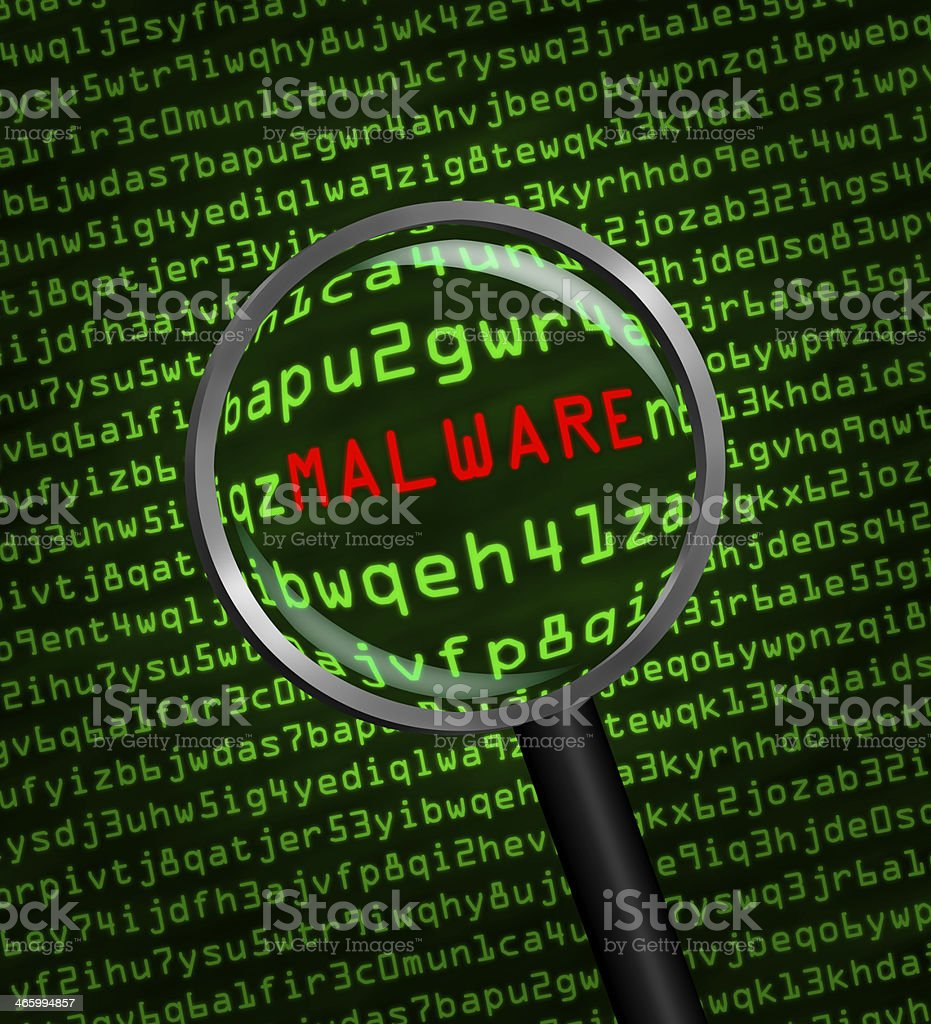 Magnifying glass locating malware in computer code stock photo