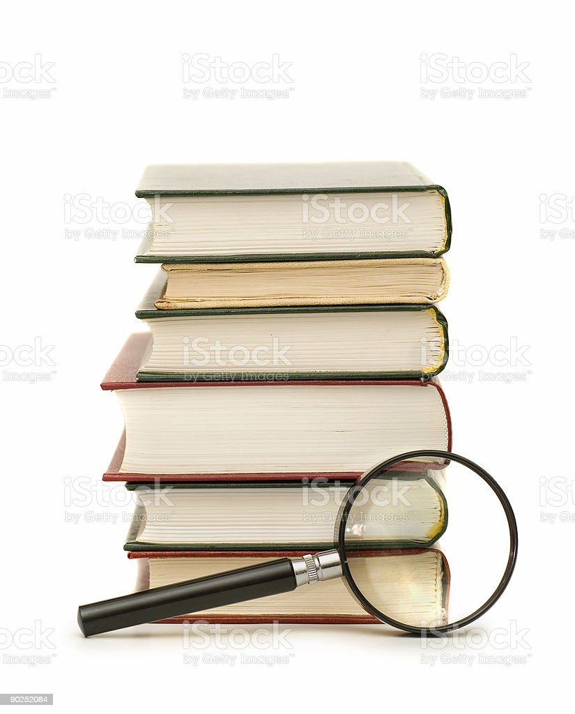 Magnifying Glass Near Books royalty-free stock photo