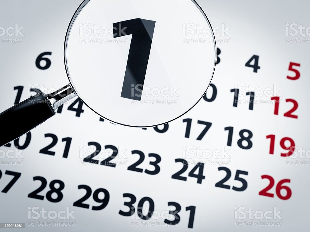 Magnifying glass on a calendar royalty-free stock photo