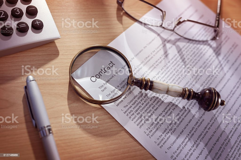 Magnifying glass on a legal contract stock photo