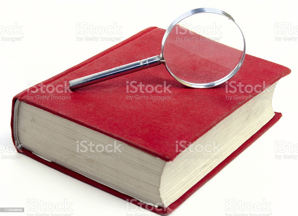 Magnifying glass on a red book stock photo