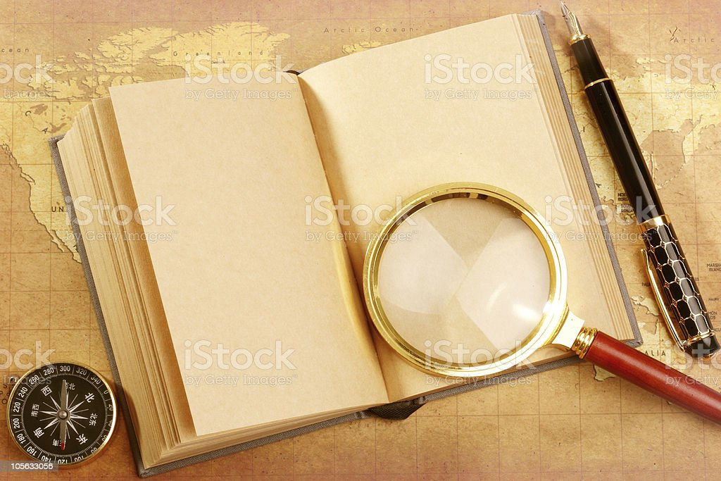 magnifying glass on book royalty-free stock photo