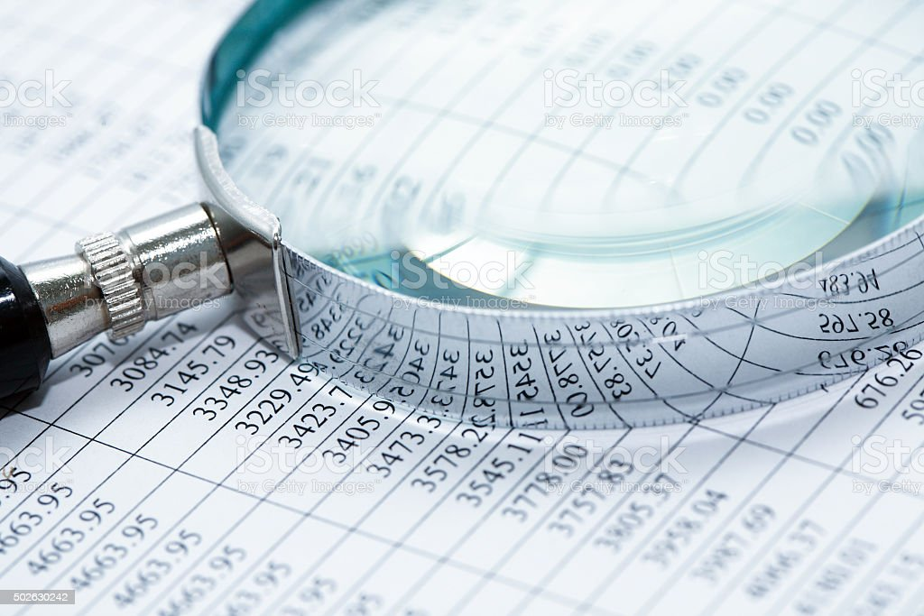Magnifying Glass On Digits stock photo