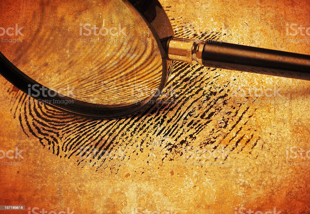 Magnifying glass on Fingerprint stock photo