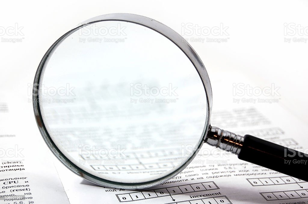 A magnifying glass on scientific papers royalty-free stock photo
