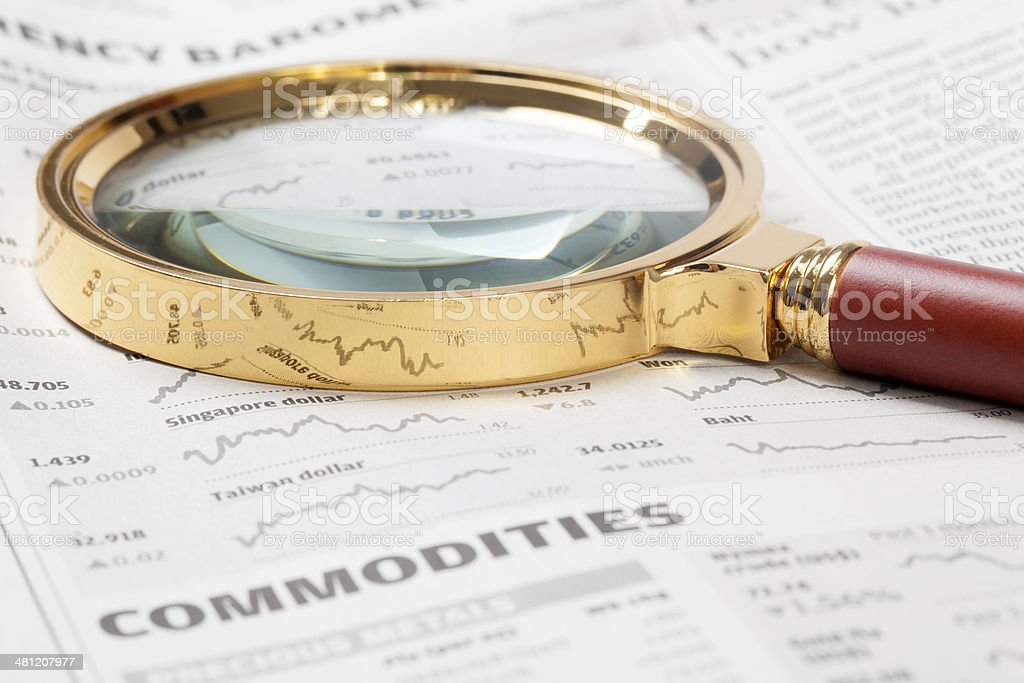 Magnifying Glass on Stock Market Data royalty-free stock photo