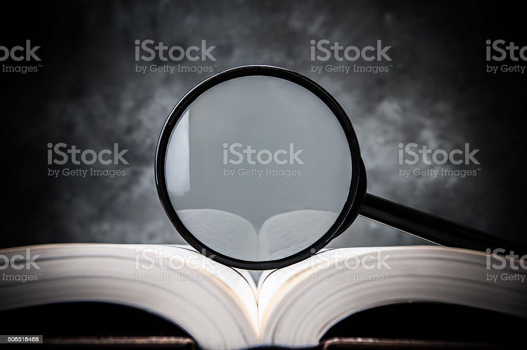 magnifying glass on the book stock photo