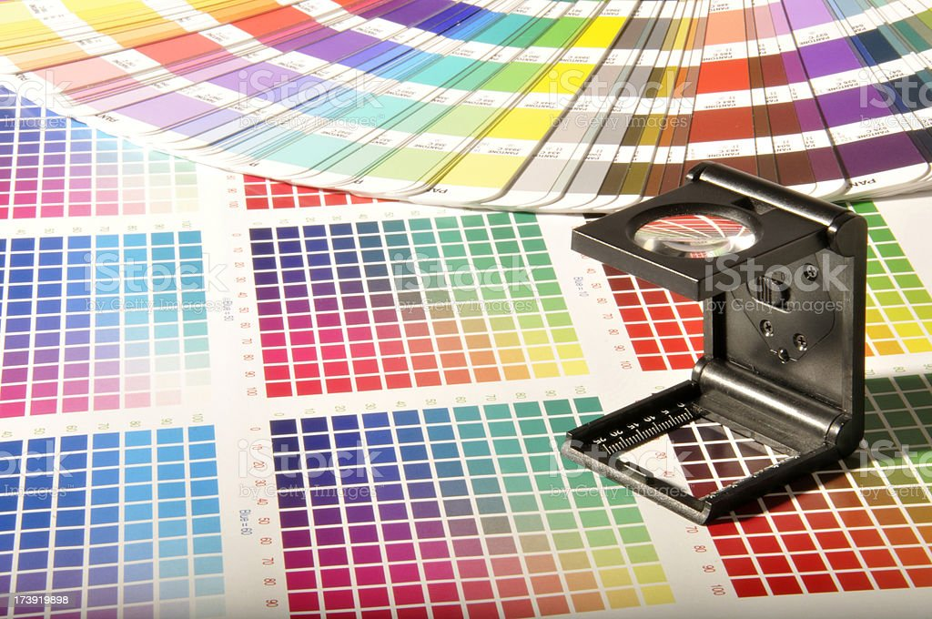 Magnifying Glass on the CMYK and Pantone Swatches. stock photo