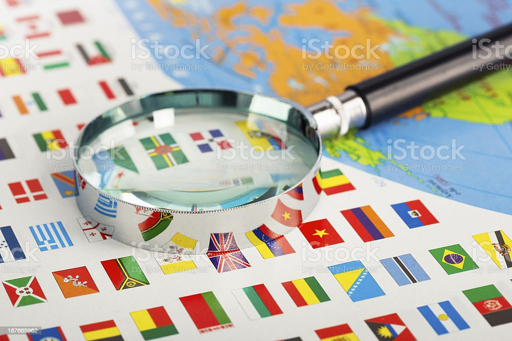 Magnifying glass on the flags stock photo