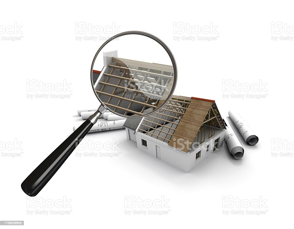 Magnifying glass over a house under construction royalty-free stock photo