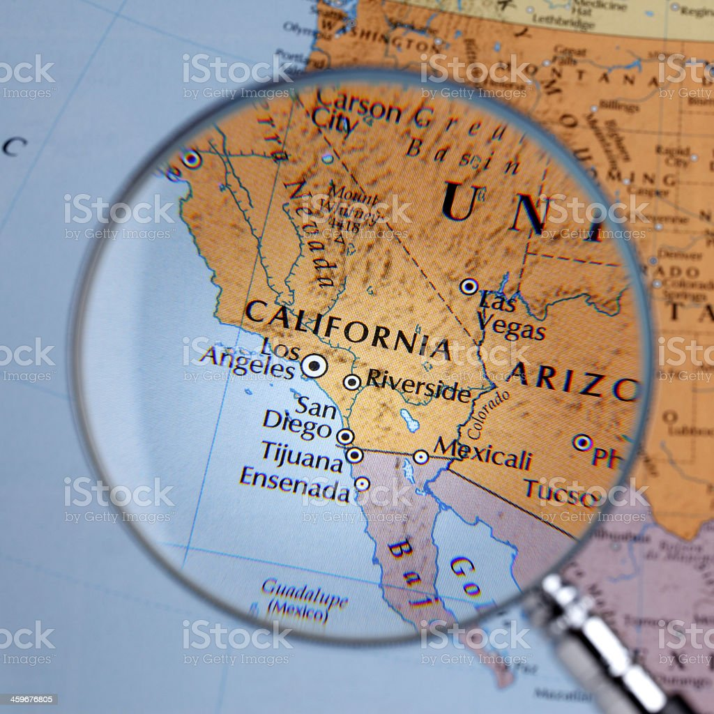 Magnifying glass over a map of CALIFORNIA stock photo