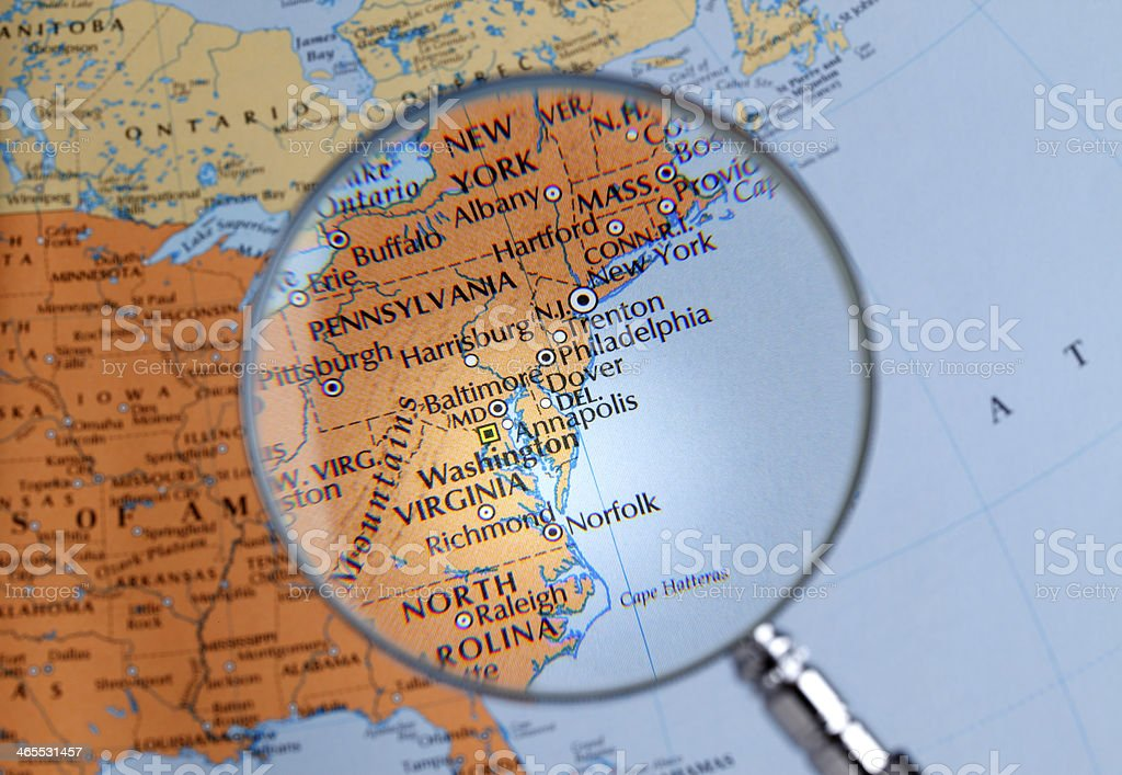 Magnifying glass over a map of East Coast stock photo