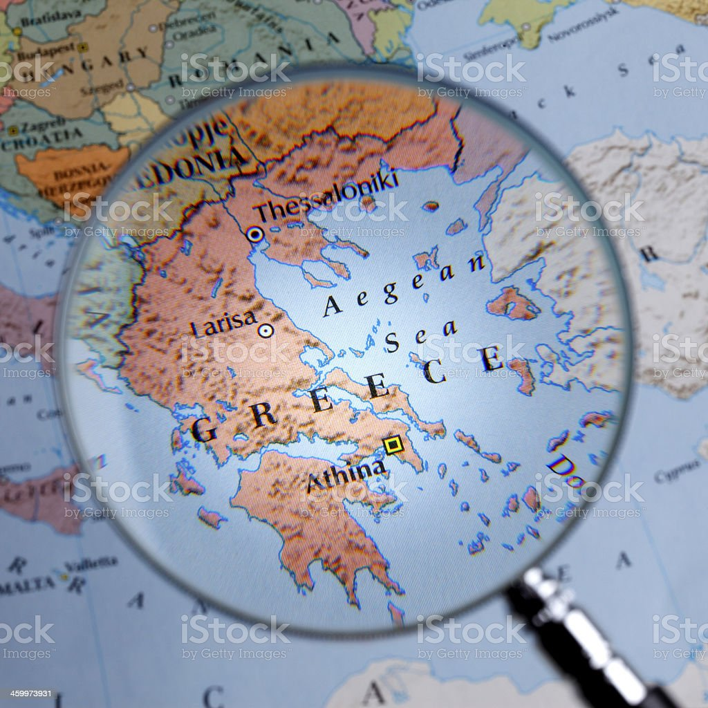 Magnifying glass over a map of GREECE stock photo