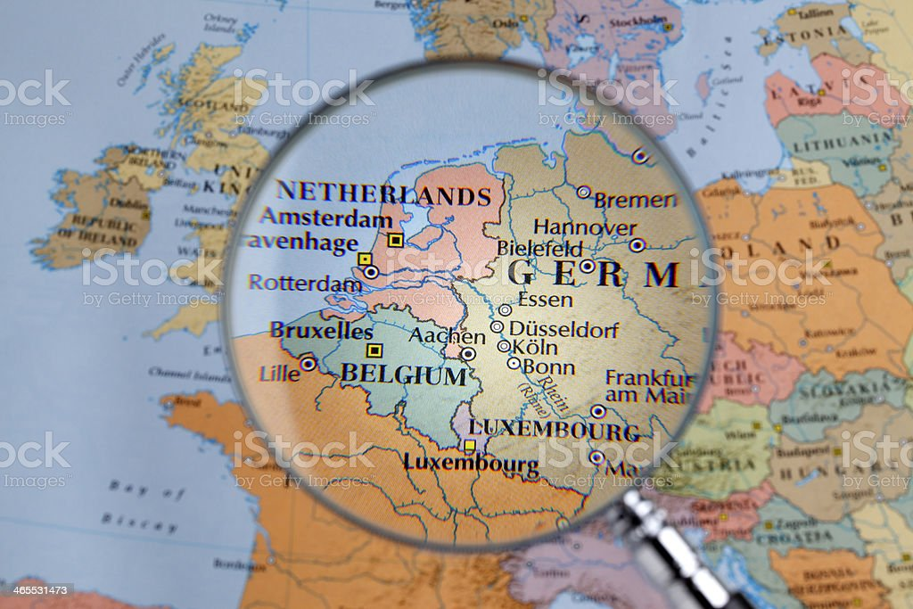 Magnifying glass over a map of  Western Europe stock photo