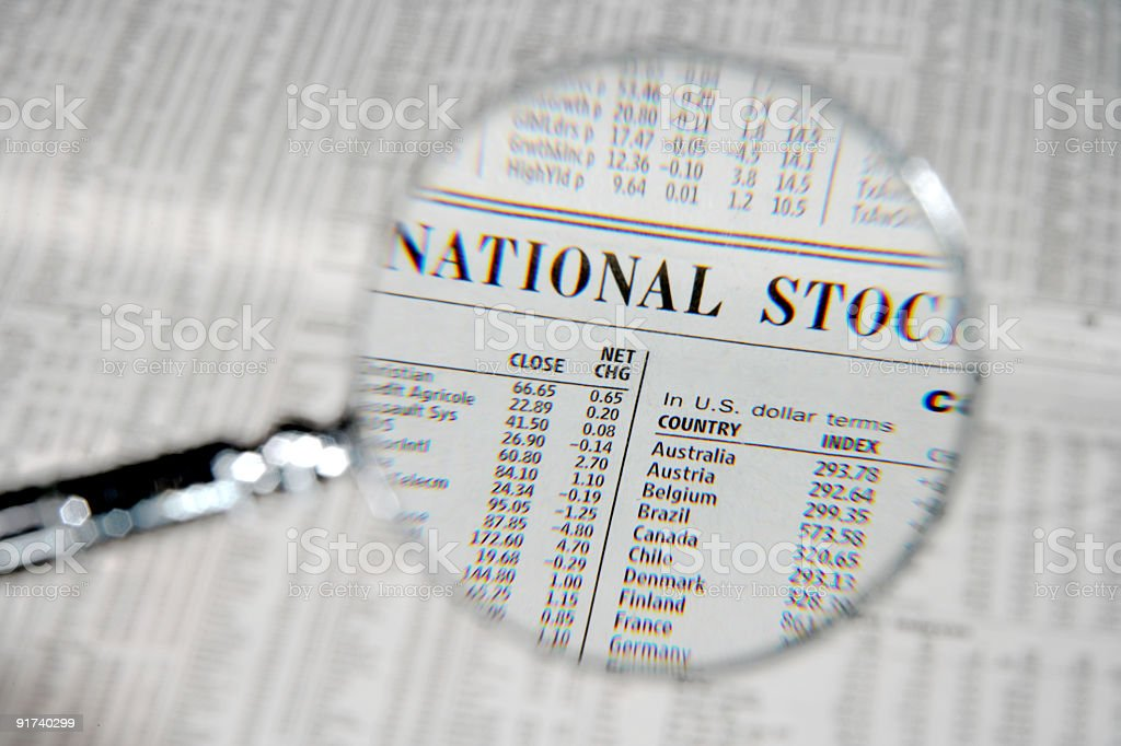 Magnifying glass over business section royalty-free stock photo