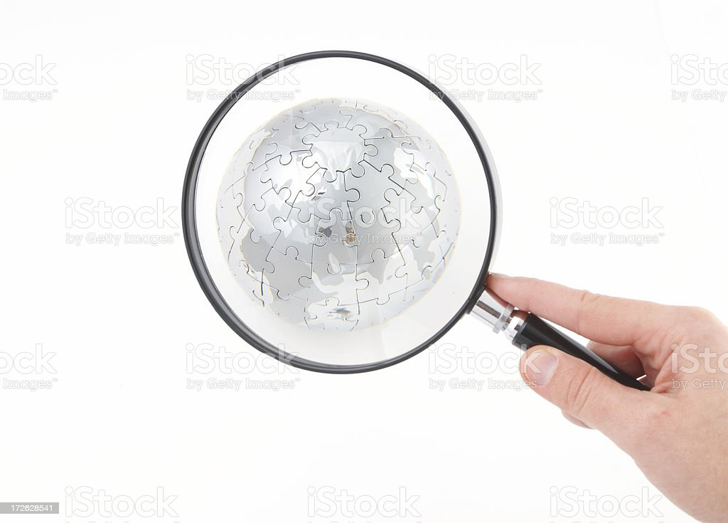 Magnifying glass over glove royalty-free stock photo