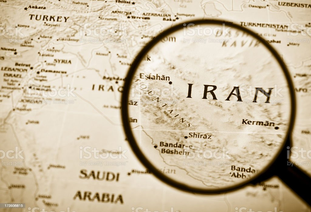 Magnifying glass over Iran in a map. (XXL) royalty-free stock photo