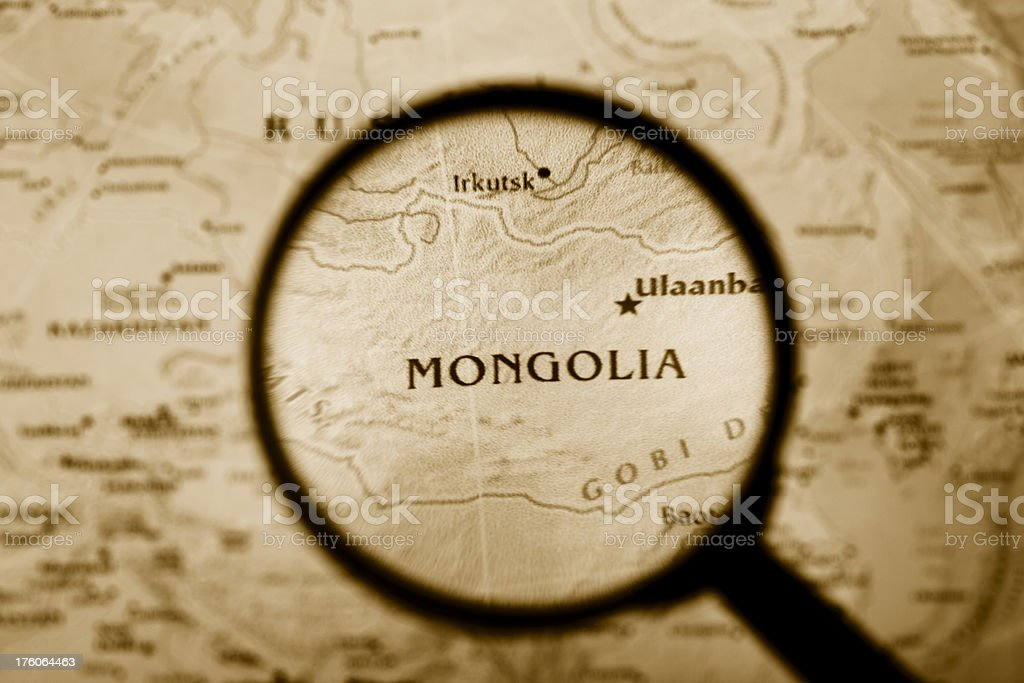 Magnifying glass over Mongolia in a map. (XXL) royalty-free stock photo